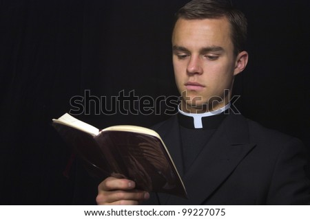Priest with Prayer book - stock photo