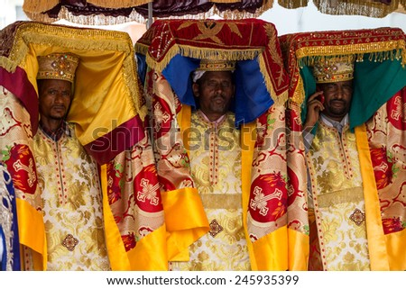 Priests carry the Tabot, a model of the Arc of Covenant, during a colorful procession of Timket celebrations of Epiphany, commemorating the baptism of Jesus, on January 19, 2015 in Addis Ababa. - stock photo