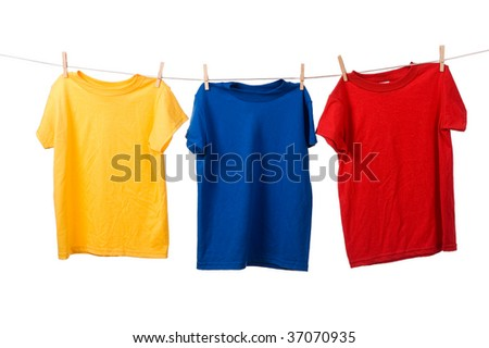 Primary colored t-shirts on a clothesline on white background, red, blue, yellow shirts - stock photo