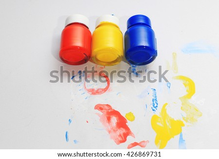 Primary colors red, yellow and blue on white paper