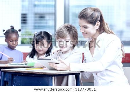 Primary multi ethnic school scene. - stock photo