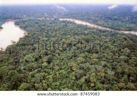 Primary rainforest viewed from the air with the Rio Aguarico in the background, Ecuador - stock photo