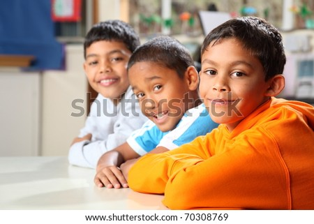 Primary school boys sitting patiently in class focus on front boy