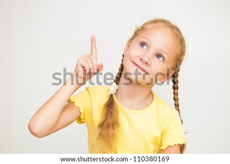 Primary school child signal with raised hand - stock photo
