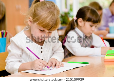 Primary school pupils during the exam - stock photo