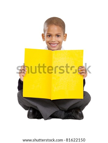 primary schoolboy sitting on floor and reading - stock photo