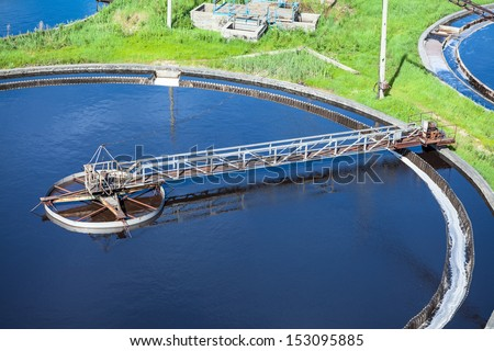 Primary sedimentation basin, sewage flowing through large tanks - stock photo