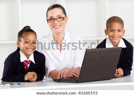 primary teacher and students portrait - stock photo