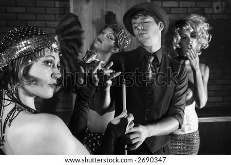 Prime adult Caucasian retro female taking money from Caucasian prime adult retro male in pool hall. - stock photo