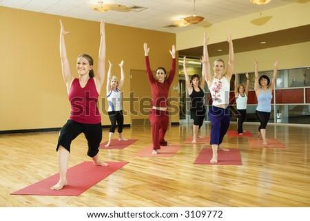 Prime adult female Caucasians in yoga class. - stock photo
