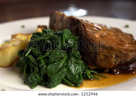 Prime Rib and Spinach - stock photo