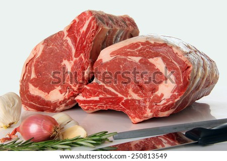 Prime rib raw beef roast on white.  - stock photo