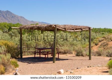 Primitive picnic area in the Rio Grande river valley - stock photo