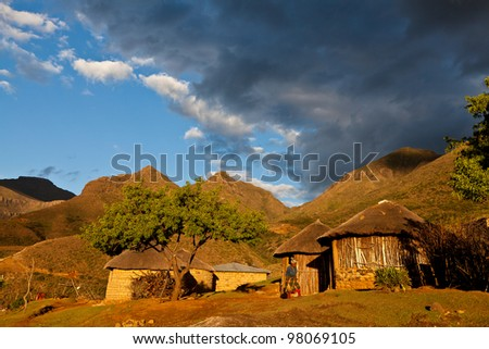 Primitive village in the mountains  in beautiful evening light - stock photo
