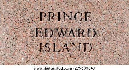 Prince Edward Island sign engraved in a rock plate - stock photo