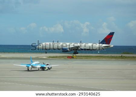 PRINCESS JULIANA AIRPORT, ST MAARTEN - JUNE 10, 2015:Delta Air Lines Boeing 757 plane landing at Princess Juliana International Airport . Airport serves the Dutch part of the island of Saint Martin. - stock photo