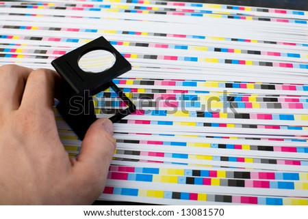 Print Loupe. Prepress color management in printing production - stock photo