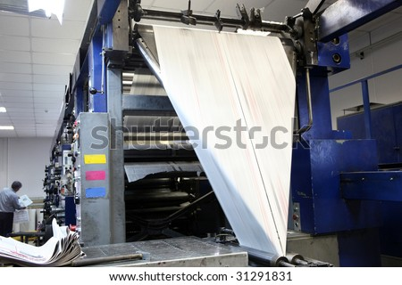 Print machine prints the newspaper - stock photo