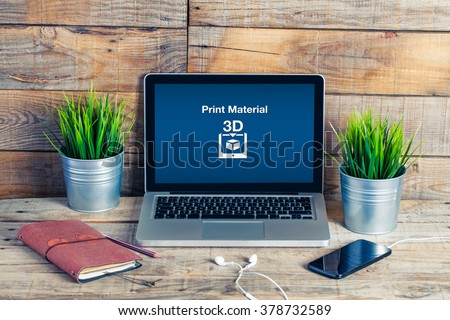 Print Material message on a laptop computer. 3D Printing computer order. Laptop in a wooden desk office. - stock photo