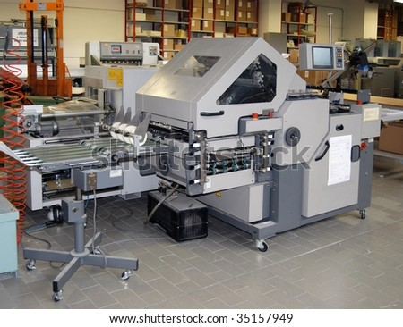 Print shop - Finishing line: offset e digital press. - stock photo