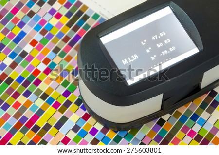 Print Spectrophotometer color measurement. Press offset color management lab values.  - stock photo