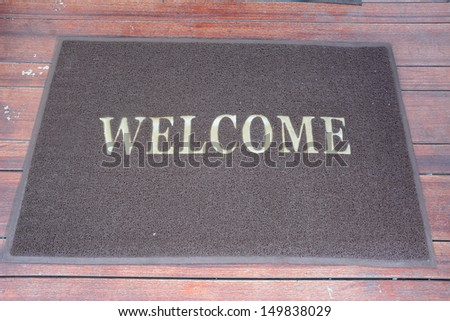print the words are welcome on the mat  - stock photo