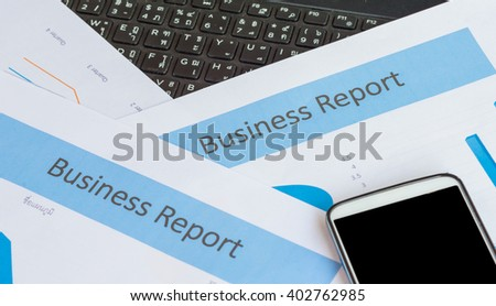 Printed Business Annual Report in Charts and smartphone .business concept. - stock photo