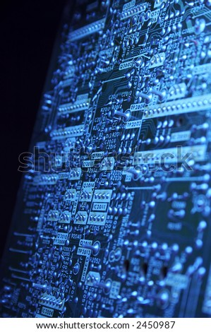 Printed circuit blue texture close up - stock photo