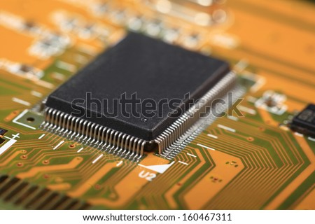 Printed Circuit Board with many electrical components, electronics computer part chip - stock photo