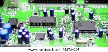 Printed circuit board with radio parts closeup. - stock photo