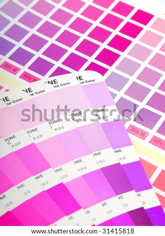 Printed color chart and a color guide (purple) - stock photo