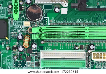 Printed computer motherboard with microcircuit, close-up - stock photo