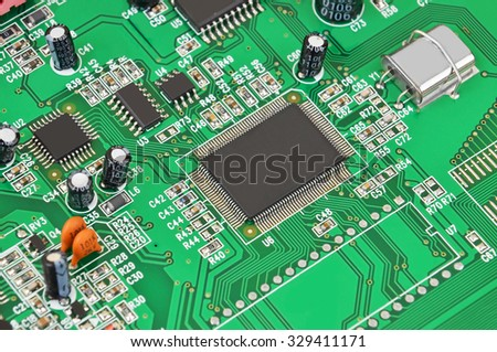 Printed computer motherboard with microcircuit, close up