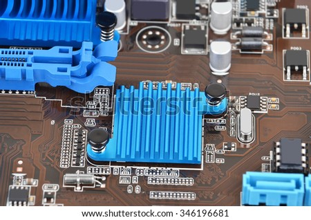 Printed computer motherboard with microcircuit, close up, DOF - stock photo