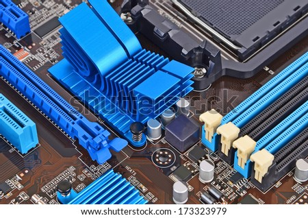 Printed computer motherboard with RAM connector slot - stock photo