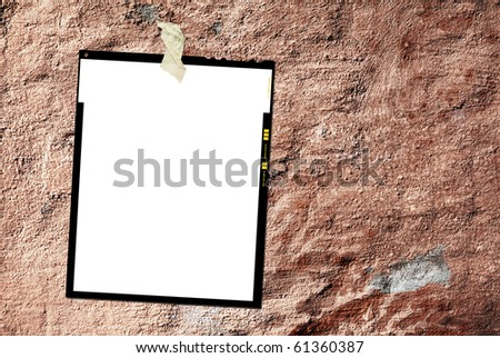 Printed large format film sheet, against grungy background, empty frame, free picture or copy space - stock photo