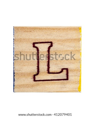 Printed letter L on wooden alphabet block. Isolated on white