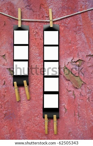 Printed medium format film strips, against grungy background, empty frames, free picture or copy space - stock photo