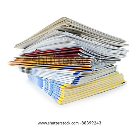 Printed paper publications stacked in a pile isolated on white - stock photo