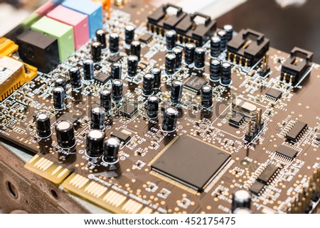 Printed sound card with microcircuit, close up - stock photo