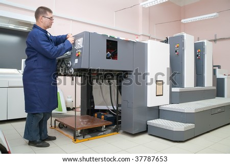 Printer at the new printed machine in a modern printing house