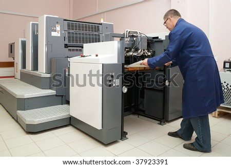 Printer working at his new offset machine