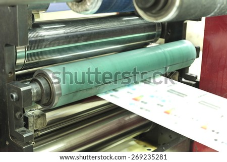 Printing at high speed on offset machine. Label, Rolled Up, Printing Out, Group of Objects, Merchandise - stock photo