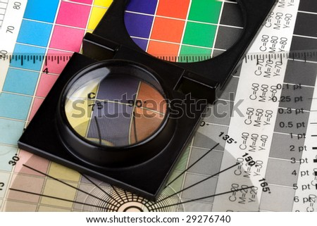 Printing color management set with magnifyer and swatches - stock photo