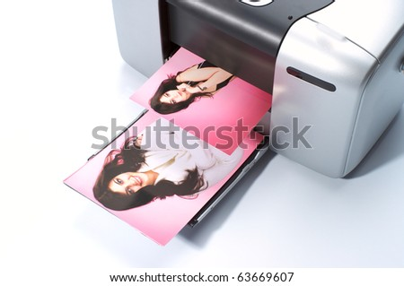 Printing colorful photos on small printer - stock photo