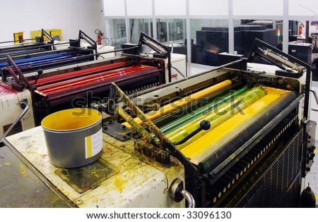 Printing - Offset press. Offset press is a printing machine designed to produce fine quality reproductions. - stock photo