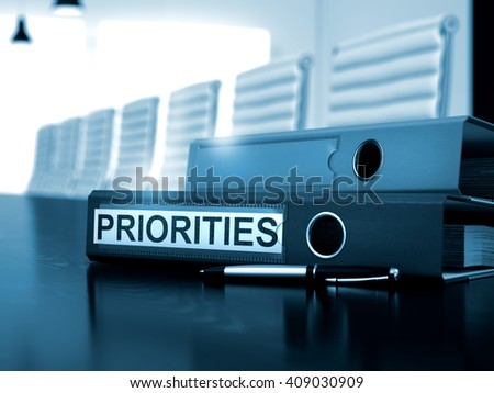 Priorities - Business Concept on Toned Background. Priorities - File Folder on Wooden Office Desk. Toned Image. 3D Rendering.  - stock photo