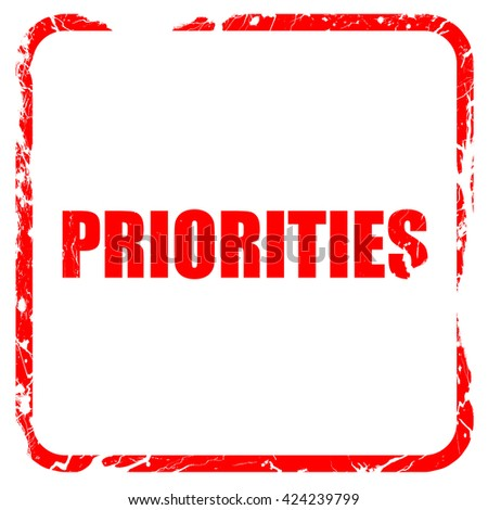 priorities, red rubber stamp with grunge edges - stock photo
