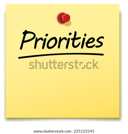 priorities, yellow paper note pinned to a notice board - stock photo