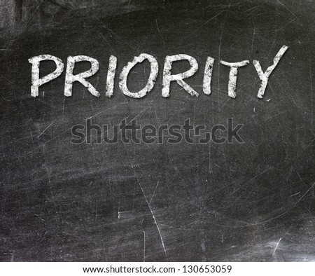 Priority as a concept written with chalk on a blackboard